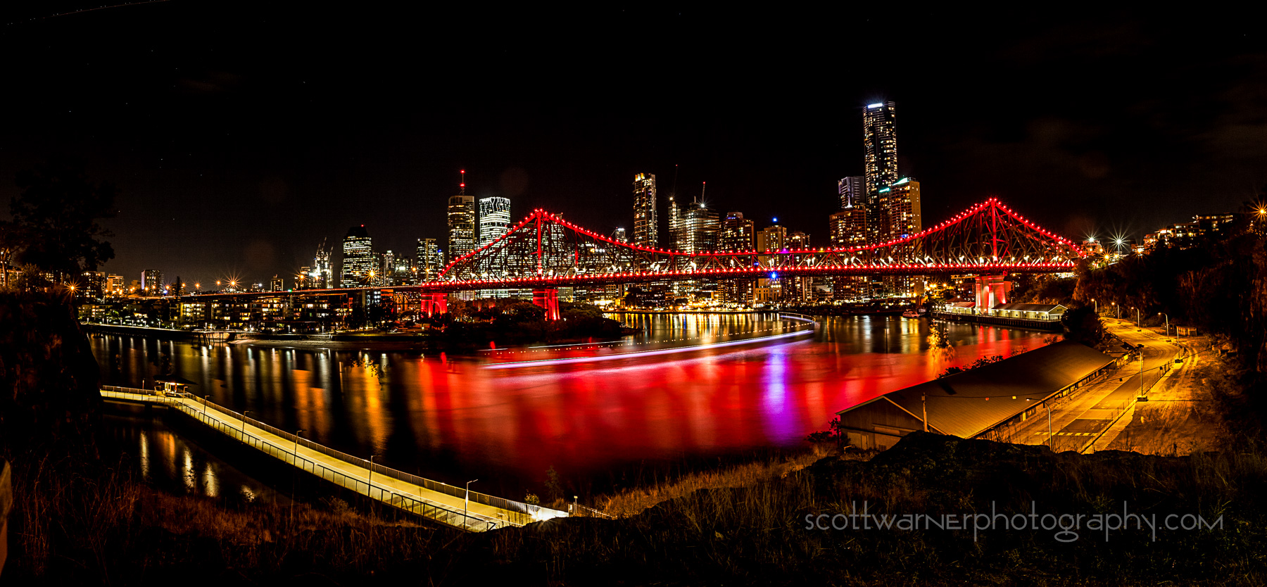a 4 image panorama of Brisbane City from the New Farm area. I waited until the Citycat Ferry came past to get the curve of light in the river